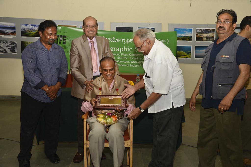 Sri. T S Srinivasa Rao being felicitated
