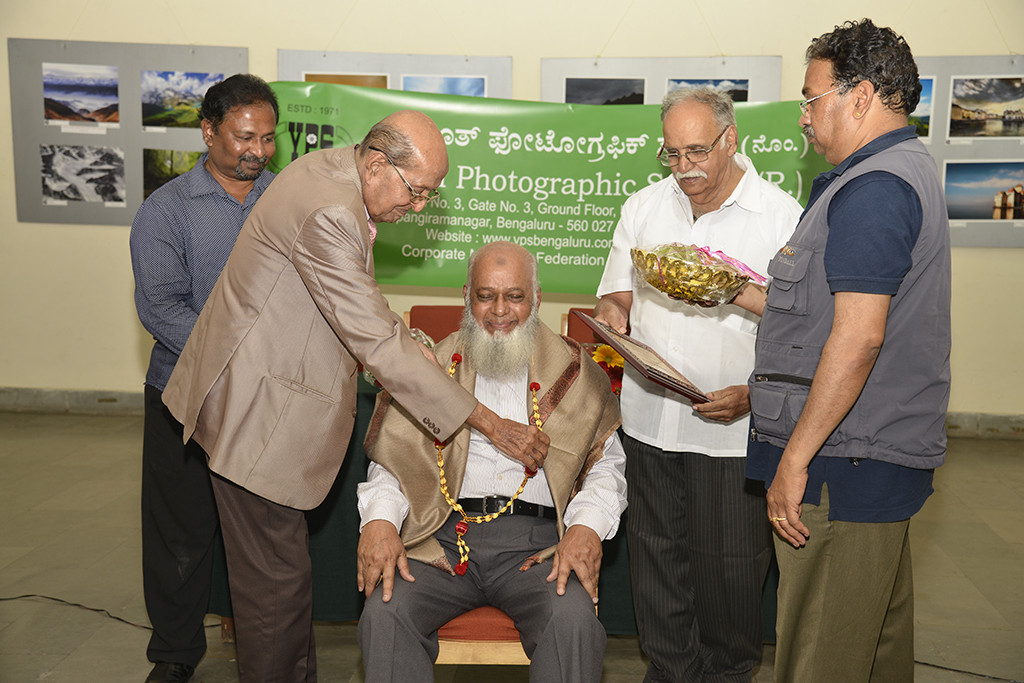 Md. Arfan Asif's proud father receiving Hon-YPS on behalf of Asif