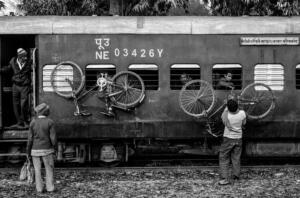 Intergrated transport at work in Manjhra Purab in Uttar Pradesh where bicylces are regularly hung up on railway coaches