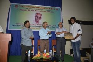 MN Jayakumar presenting his book to Yeshwanth Lakshminarayana