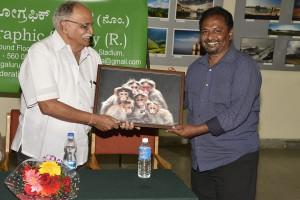 Satish Presenting Monkeys of Valparai to Basavaraj