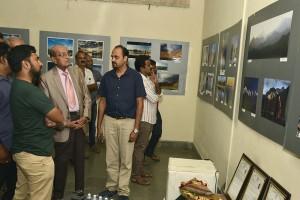 Bhagavan looking at Arjun's Himalayan Pictures